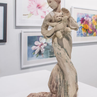 female with baby sculpture